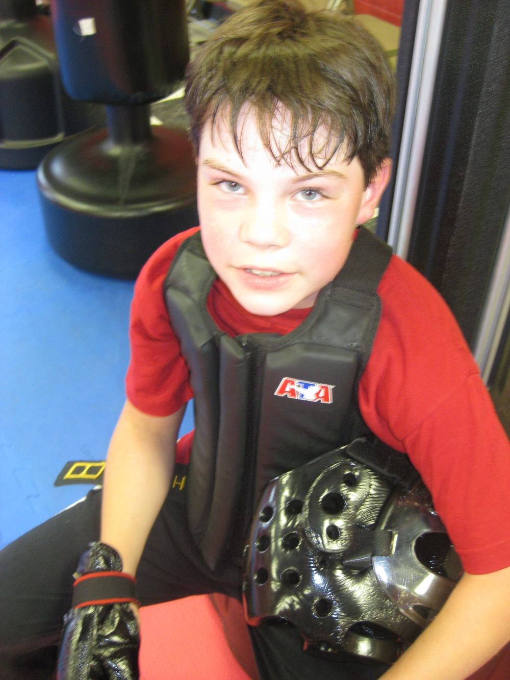 My tough guy Micah.  In this picture he is resting after a few rounds of sparring in karate.