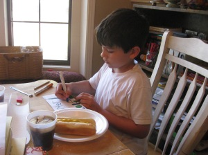 The boy LOVES to draw!